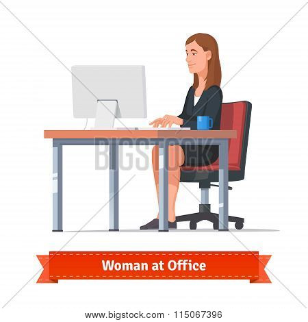 Woman working on a desktop at the office table