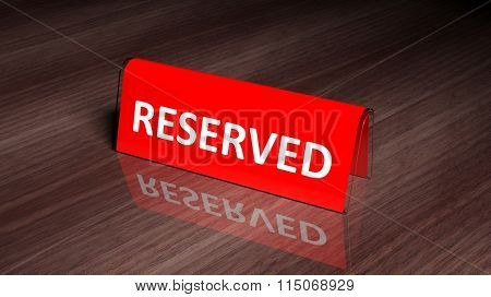 Red glossy reservation sign on wooden surface with reflection