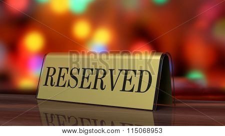 Golden glossy reservation sign on wooden surface, with festive background.