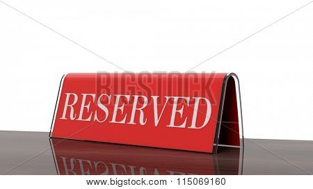 Red glossy reservation sign on wooden surface, isolated on white background.