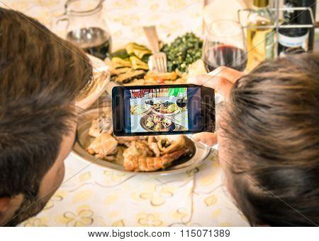 Couple Of Boyfriend And Girlfriend Taking A Food Selfie In Dinner Restaurant