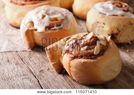 Cinnamon Rolls With Almond Macro On The Table. Horizontal