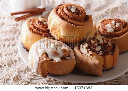 Freshly Cinnamon Rolls With Almond Close Up And Coffee. Horizontal