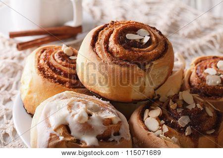 Freshly Baked Cinnamon Rolls With Icing And Almonds Macro. Horizontal