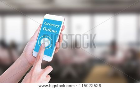 Mobile touch screen phone with text Grocery online on the screen