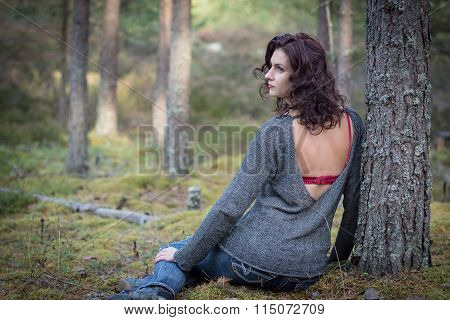 Beautiful woman in mossy forest