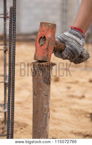 Worker Hammering Eucalyptus Pointed