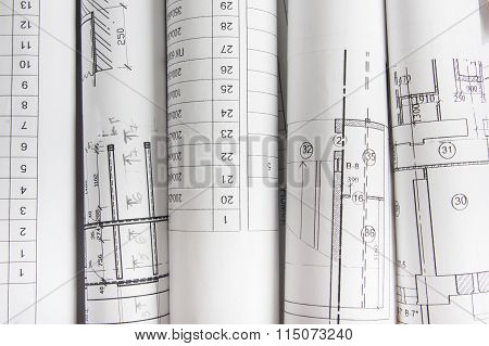 Workplace of architect - Architectural project, blueprints, rolls and tablet, pen, divider compass o