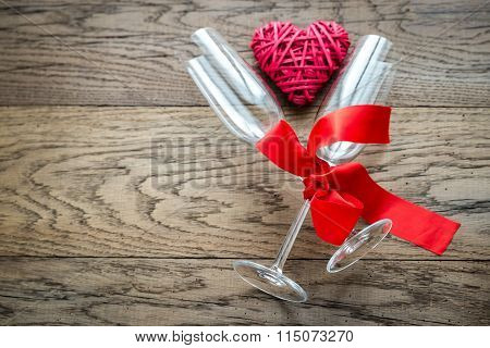 Two Flutes With Retro Cane Heart On The Wooden Background