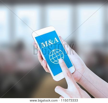Mobile touch screen phone with text M&A on the screen