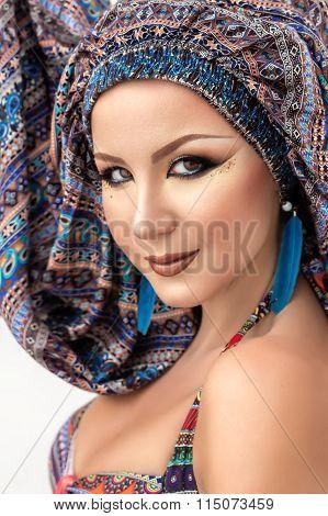 Portrait beautiful woman, arabic makeup, colorful turban