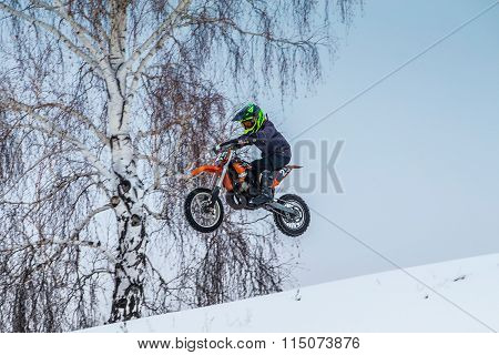 young motorcycle racer motorcycle flies after jumping over mountain