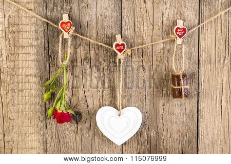 Red Rose With White Shape Heart And Chocolate On Wooden