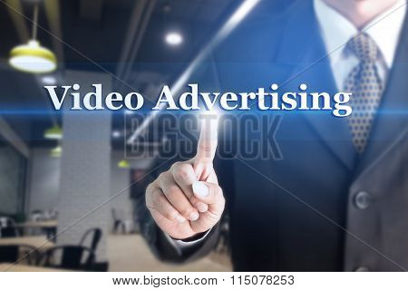 Businessman holding a white sign with the message Video Advertising.