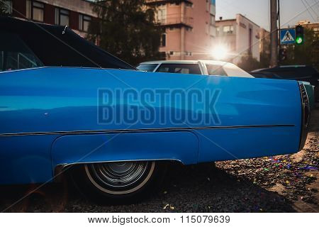 side view of blue vintage retro car