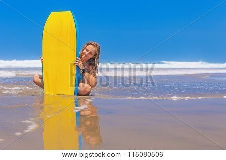 Beautiful Girl With Surf Board On Sea Beach With Waves