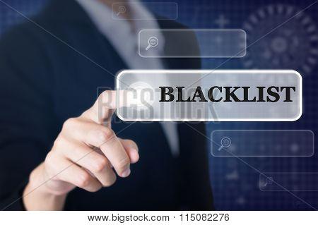 Businessman pressing a BLACKLIST concept button.