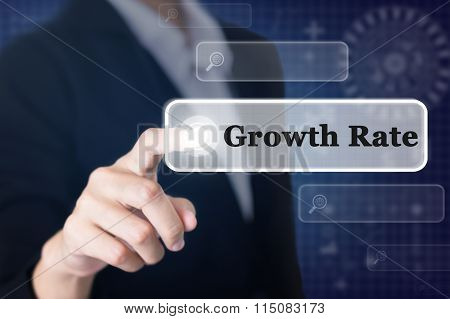 Businessman pressing a Growth Rate concept button.