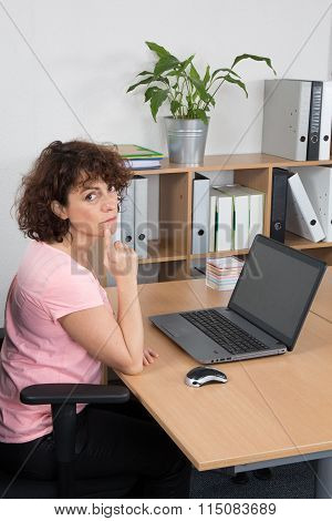 Middle-aged Woman Working On Laptop At Office