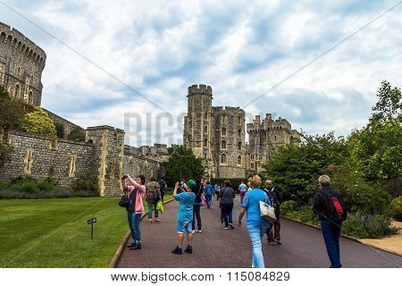 Unidentified Tourists Near Medieval Buildings Inside Windsor Castle