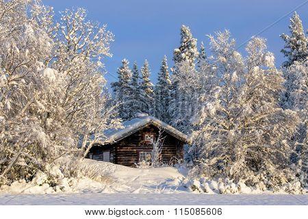 Cabin in beautiful winter landscape