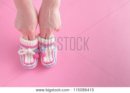 Female Hold Tiny Newborn Booties
