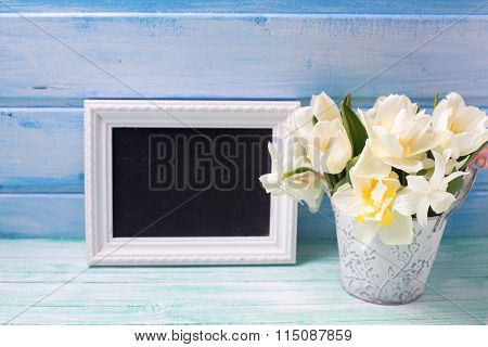 Bright White Daffodils And Tulips  Flowers In Bucket  And Empty Blackboard
