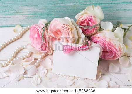 Pink Roses, Pearl  And Empty Tag On White Background Against Turquoise Wall.