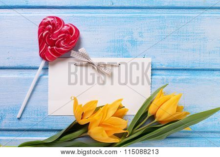 Background With Fresh  Spring Yellow Tulips, Lollypop In Form Of Heart And Empty Tag