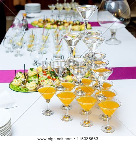 Pyramid Of Glasses With Drinks And Wine On Banquet Table