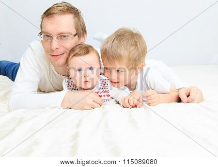 father with infant daughter and little son