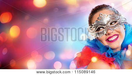 Attractive Woman Smiling With Carnival Mask