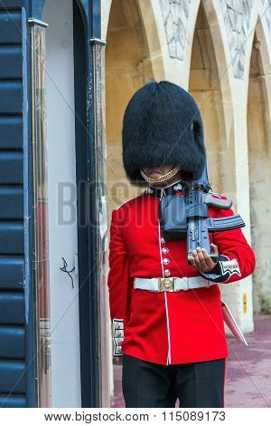 Unidentified  British Queen's Guard marching on duty inside Windsor Castle