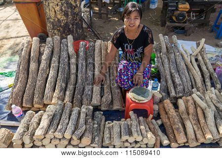 Young Myanmar girls with thanaka in her shop