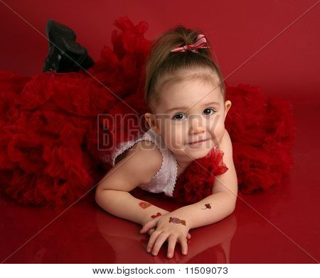 Adorable Little Girl In Red Pettiskirt Tutu And Black Boots