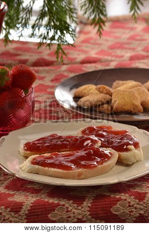 Blackberry jam on toast bread on rustic table.