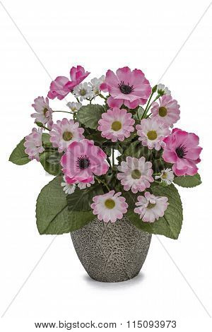 Bouquet Of Artificial Flowers In A Ceramic Vase Isolated On A White Background