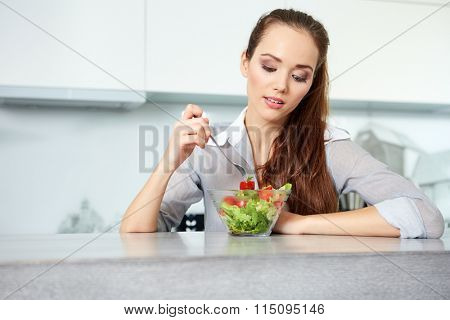 Beautiful Young Woman Eating Vegetable Salad .Dieting concept.Healthy Food
