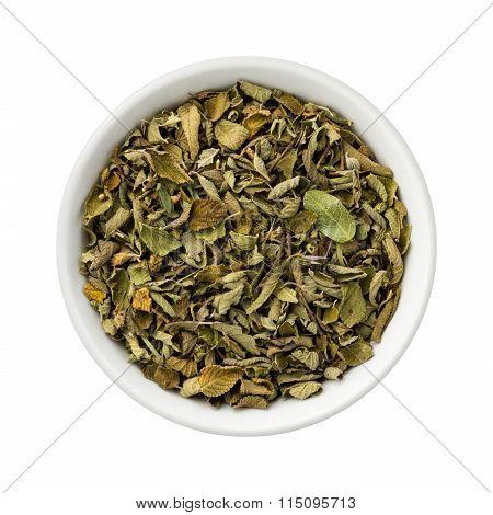 Dried Oregano Leaves In A Ceramic Bowl