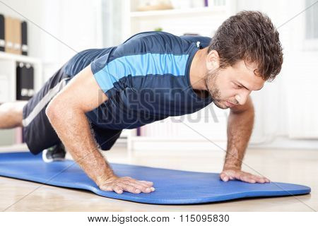 Determined Fit Young Man Doing Planking Exercise