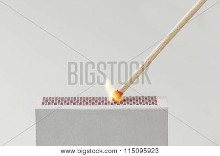 Match Lit On A Matchbox