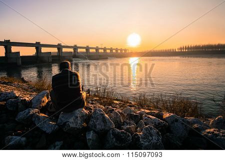 a man contemplating sunset