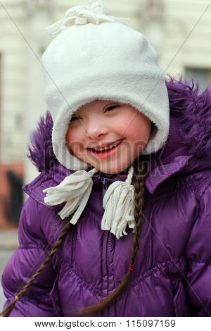 Young Girl Smiling In The Winter