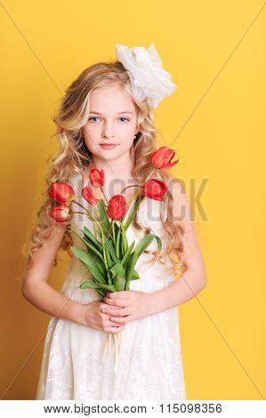 Kid girl with tulips