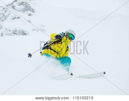Winter freerider in deep powder.