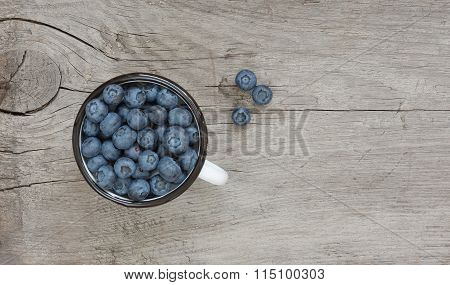 Blueberries In The Enamel Mug
