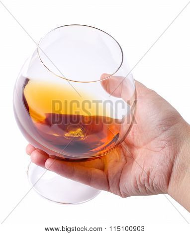 Glass With Cognac In A Hand On White Background