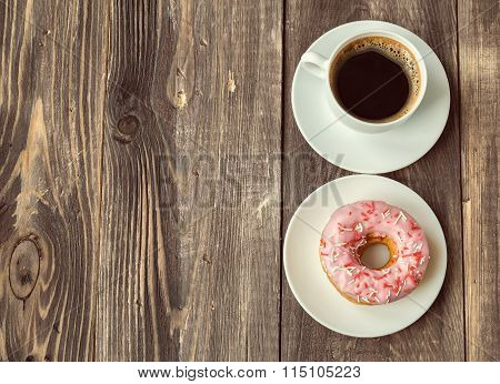 Coffee And Donut On Wooden Background