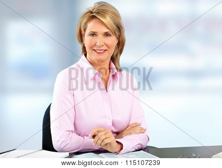 Smiling mature business woman. Blue bakground