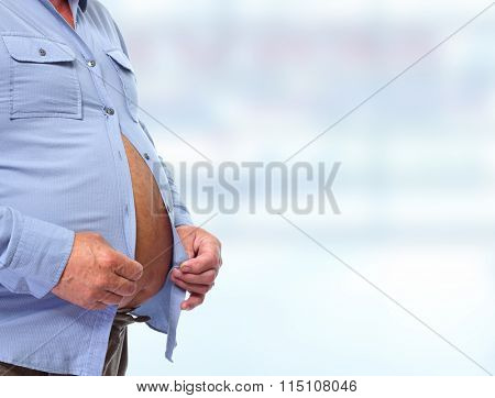 Big fat belly over blue background.